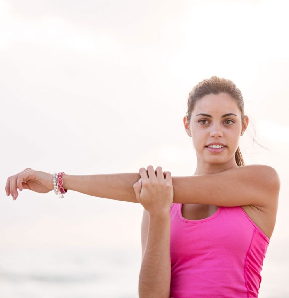 Woman stretching arms and neck
