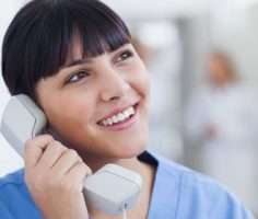 Triage nurse speaking on the phone with a patient